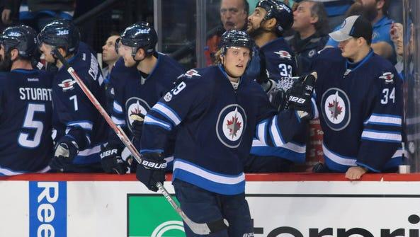 Winnipeg Jets forward Patrik Laine (29) celebrates