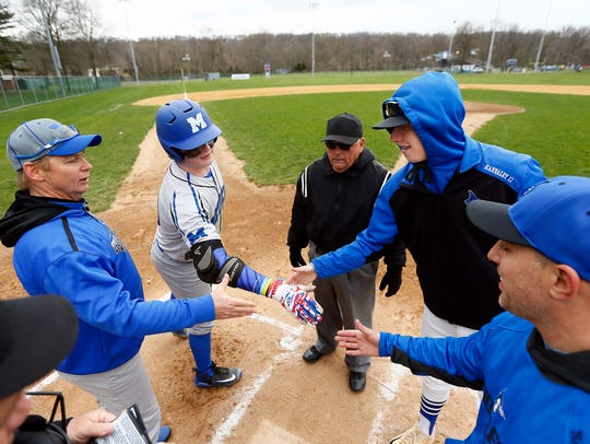 Metuchen's Manager Leo Danik and third baseman Mike