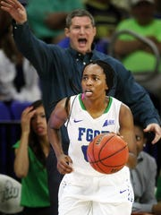 FGCU's Dytiesha Dunson leads a fast break against Harvard as FGCU head coach Karl Smesko calls out a play Saturday at Alico Arena in Fort Myers.