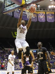 LSU forward Jordan Mickey (25) dunks the ball in front of Southern Miss Golden Eagles guard Matt Bingaya (2) in the first half at the Pete Maravich Assembly Center.