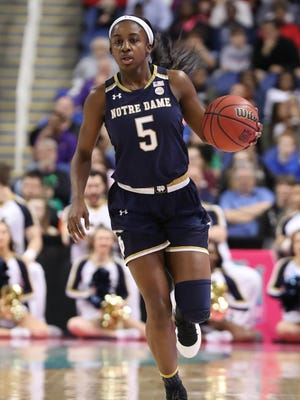 Notre Dame Fighting Irish guard Jackie Young (5) brings the ball up court during the first half of the ACC Womens Championship against the Louisville Cardinals at the Greensboro Coliseum.