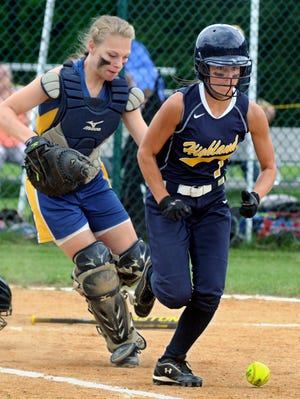 Highland High School's Julie Valentino beats out a bunt as Ellenville catcher Drew Bugna attempts to make a play on Saturday.