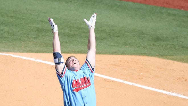 Catcher Henri Lartigue celebrates after hitting a walk-off single in Ole Miss' 6-5 win Sunday afternoon against Auburn.