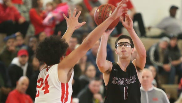 Scarsdale's Nash Goldman (1) puts up a three-point
