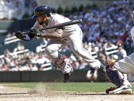 The Boston Red Sox's Jackie Bradley Jr. goes airborne as he is hit by a pitch from the Minnesota Twins' J.T. Chargoiz in the ninth inning Saturday in Minneapolis. The Red Sox won 15-4. Bradley had a three-run home run in the first inning.