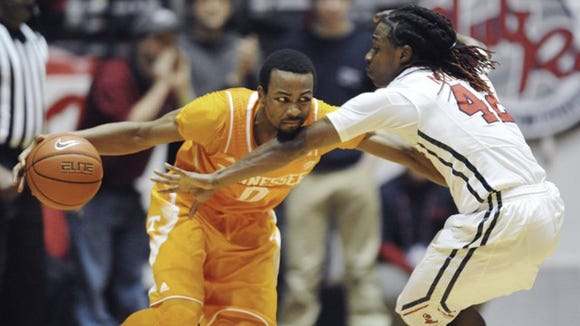 Tennessee guard Kevin Punter (0) is defended by Mississippi guard Stefan Moody (42) during an NCAA college basketball game Saturday, Feb. 21, 2015 in Oxford, Miss. (AP Photo/Oxford Eagle, Bruce Newman) MAGS OUT; NO SALES; MANDATORY CREDIT