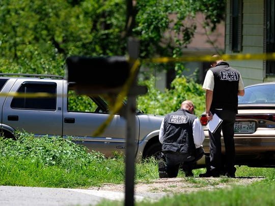 Metro police investigate a double shooting at the corner of Weakley and Bessie avenues in the Katie Hill neighborhood.