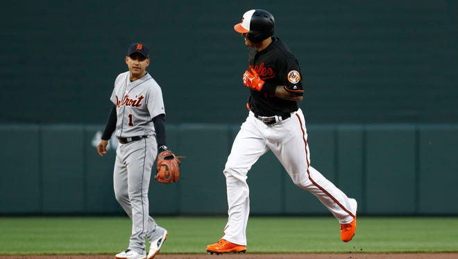 Baltimore Orioles' Manny Machado, right, rounds the bases past Detroit Tigers shortstop Jose Iglesias after hitting a solo home run during the first inning on Friday.