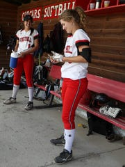 Foothill softball players Tayler Walker, left, and