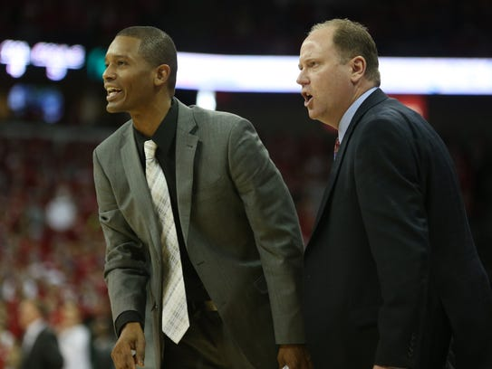 Wisconsin Badgers assistant coach Lamont Paris, left,
