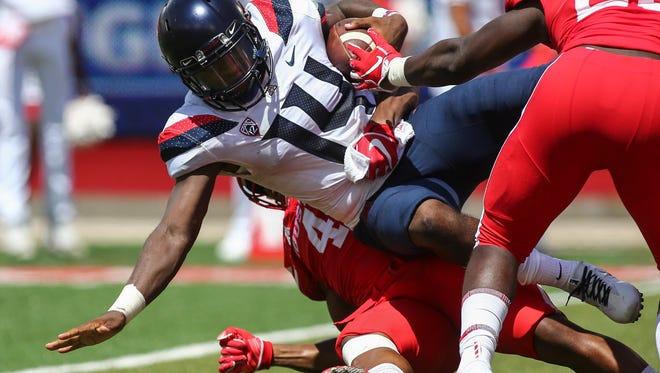 Sep 8, 2018; Houston, TX, USA; Arizona Wildcats quarterback Khalil Tate (14) is tackled by Houston Cougars linebacker Leroy Godfrey (4) near the goal line during the fourth quarter at TDECU Stadium. Mandatory Credit: Troy Taormina-USA TODAY Sports