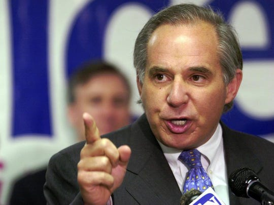 Sen. Robert Torricelli, D-NJ, addresses supporters at his victory rally in the Democratic primary election in June 2002.