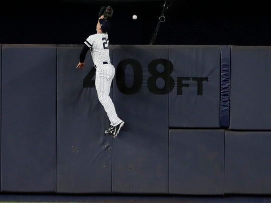 New York Yankees center fielder Jacoby Ellsbury attempts