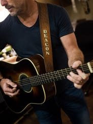 Charles Esten plays the guitar he uses on the television
