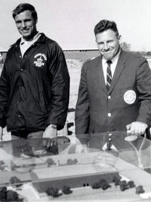 Athletic director Marvin Gans (right) and physical education instructor Jack Washka in October 1968 at the groundbreaking for Schoolcraft College's athletic complex, which is still in use today. Gans, who died Friday, was Schoolcraft's first athletic director.