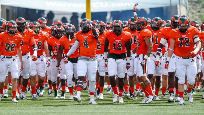 CSU players, wearing their orange Ag Day jerseys and special helmets, prepare to take the field at Hughes Stadium before last year's game against Savannah State The Rams will wear their Ag Day uniforms again Saturday, when they take on Northern Colorado at Hughes Stadium..