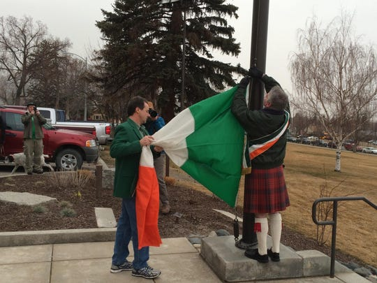 Gov. Steve Bullock, left, helps Patrick Flaherty of the Gen. Thomas Francis Meagher Division of the Hibernians raise the Irish flag several years ago in front of the state Capitol as part of the St. Patrick's Day observance in Helena.