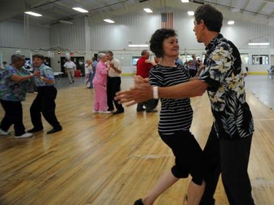 Jim Binder, right, and his wife, Pat, both of Eau Claire, dance during the June 2011 Central Wisconsin Music Festival at the MARC-Smith Center in Merrill.
