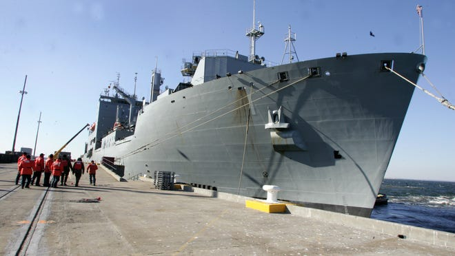 Line handlers tie down the USNS Lewis and Clark during its homecoming to Earle Naval Weapons Station in Middletown in 2008. The FBI has issued a warning to local military personnel about threats from ISIL.