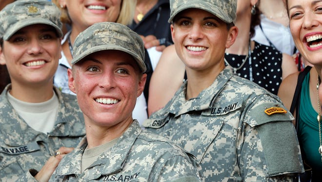 U.S. Army First Lt. Shaye Haver, center, and Capt. Kristen Griest, right, pose for photos with other female West Point alumni after an Army Ranger school graduation ceremony on Aug. 21, 2015, at Fort Benning, Ga.