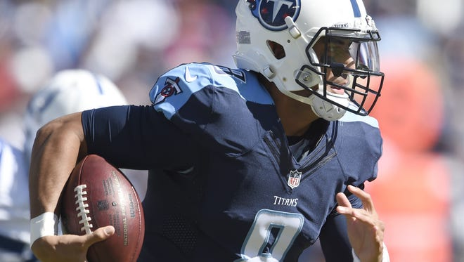 Titans quarterback Marcus Mariota (8) moves the ball in th e first quarter against the Colts at Nissan Stadium Sunday, Oct. 23, 2016, in Nashville, Tenn.