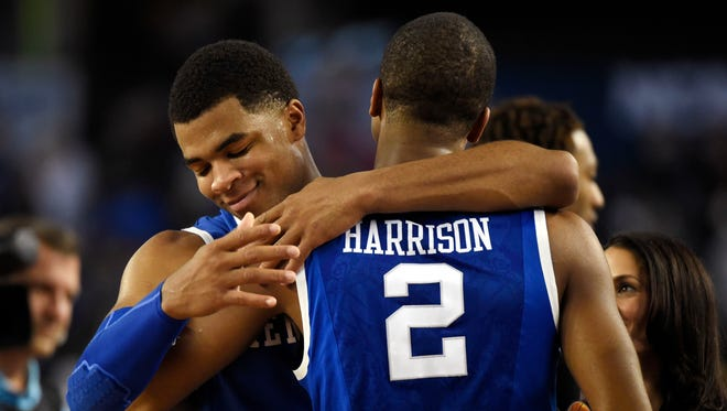Kentucky Wildcats guard Andrew Harrison (left) hugs guard Aaron Harrison (2) after defeating the Wisconsin Badgers in the semifinals of the Final Four.
