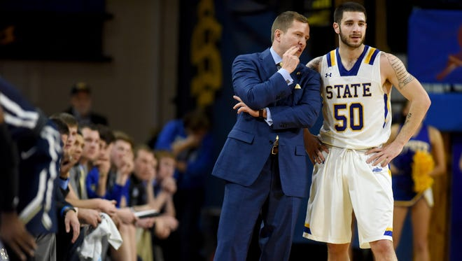 SDSU head men's basketball coach T.J. Otzelberger talks with senior guard Michael Orris during their game against Oral Roberts on Saturday at Frost Arena in Brookings.