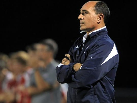 Gianni Bussani won more than 300 games in his 25 seasons as the boys varsity soccer coach at Fairport.