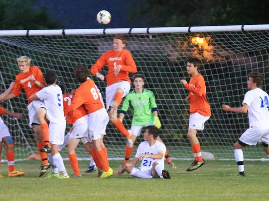 Northville goalkeeper Evan Treiber (green shirt) and his defenders hold the fort to deny Salem late during the first half.