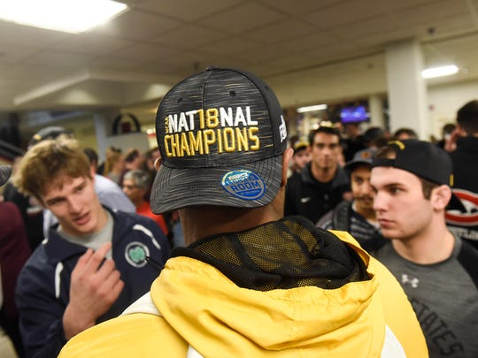 St. Cloud State wrestling team members wear their championship hats during a celebration Wednesday, March 14, for their third NCAA Division II championship in four years.