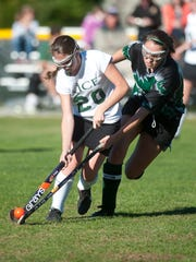Rice's Caroline Provost, left, edges out Stowe's Colleen McGovern during a game last season.