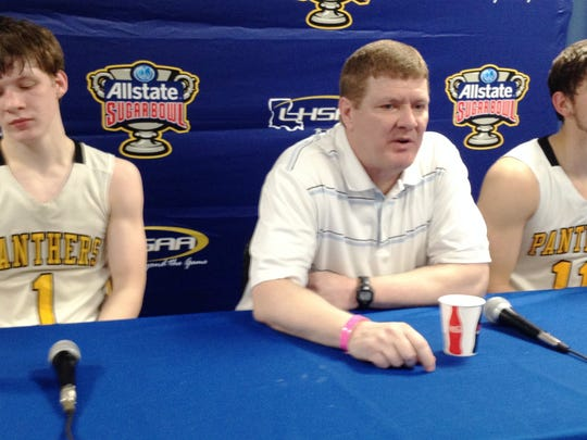 Fairview senior guard Jacob Stark (1), coach Ron Stark and junior center Brennan Maddox (11) listen to a question during the post-game media session following the Panthers' loss to Anacoco in the Class B semifinals Wednesday night in Lake Charles.