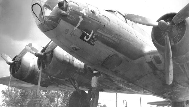 """The """"Memphis Belle"""" is being repaired for public display by Navy personnel at its new home in front of the American Legion Hut on Central Avenue, but the World War II memorial is being damaged by prowlers faster than modifications can be completed, Legion officials say on 8 Jun 1950.  Public co-operation has been invited to protect the heroic bomber from vandalism."""