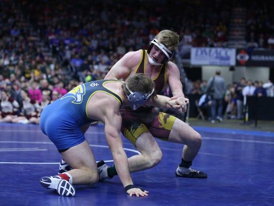 Wahlert's Kolton Bartow wrestles PCM's Lucas Roland