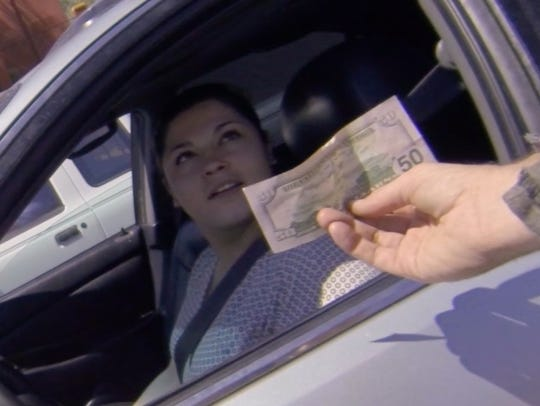 Drivers were shocked to see a man giving away money