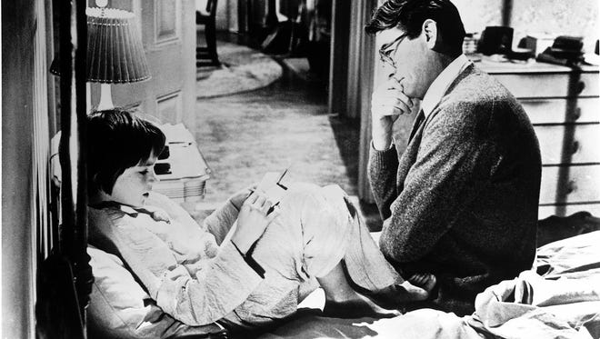 """Mary Badham and Gregory Peck in a scene from the 1962 motion picture """"To Kill a Mockingbird."""""""