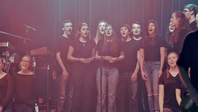 Members of the Wichita Falls High School a cappella choir performed with rock band Foreigner Tuesday night at Memorial Auditorium.
