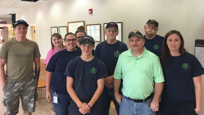 Volunteer members of the Verona Volunteer Fire Company pose for a picture after speaking at an Augusta County Board of Supervisors staff briefing in Verona, Va., on Monday, July 24, 2017. They requested an apology from two supervisors for critical comments made about the station in the News Leader.