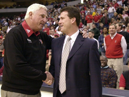 Steve Alford, during his Iowa coaching days, chats