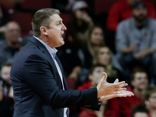 Boston College coach Jim Christian gestures during the first half of the team's NCAA college basketball game against Nebraska in Lincoln, Neb., Wednesday, Nov. 29, 2017. (AP Photo/Nati Harnik)