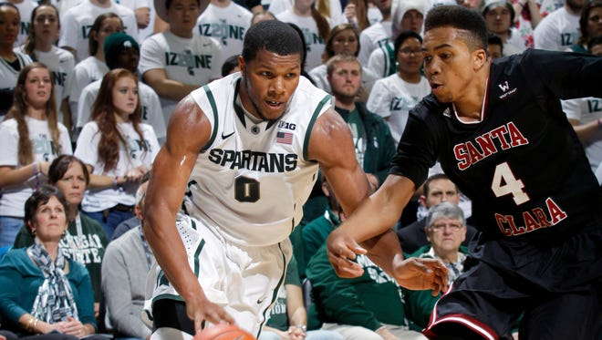 Michigan State's Marvin Clark Jr. (0) drives against Santa Clara's Jarvis Pugh during the first half Monday at Breslin Center.