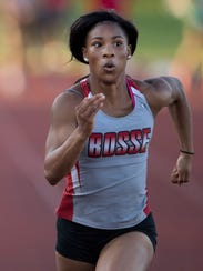 Bosse's Tionne Brigham, center, set a meet record in
