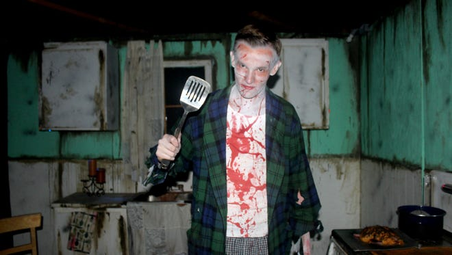 Volunteer actor Austin Yost poses in the kitchen, where Sanctum of Horror visitors pass through during their trip through Lenore's twisted past