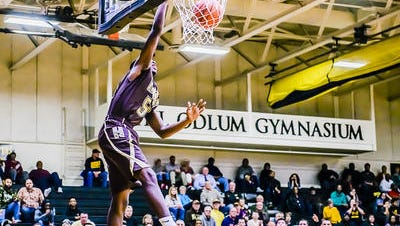 Quinton Armstrong of Holt dunks in the 2nd half of the Rams' game with Waverly Tuesday.
