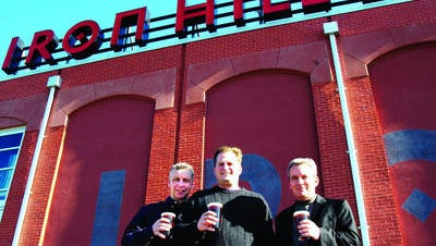 Iron Hill Brewery co-owners, Kevin Finn, Mark Edelson and Kevin Davies stand in front of their Wilmington, restaurant.