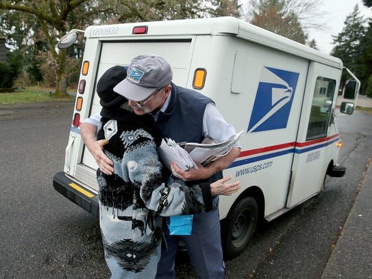 Mail carrier Norm Hall gives longtime customer Bonnie