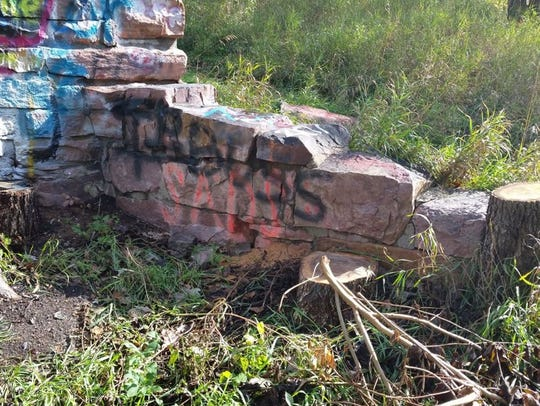 Vandals spray painted Sioux Quartzite at Gitchie Manitou
