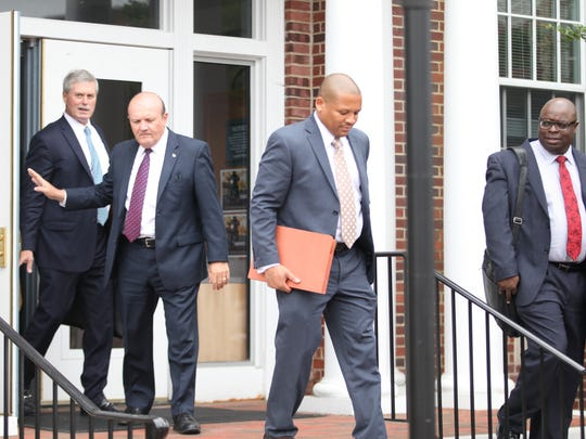 Exiting the Sussex County Court House in Georgetown on June 3 following a hearing regarding former county Chief Administrative Officer David Grimaldi are (from left) Wilmington attorney Michael Kelly, current Chief Administrative Officer Timothy Mullaney Sr., County Attorney Bernard Pepukayi and County Solicitor Darryl Parson. Grimaldi's October firing prompted two lawsuits.