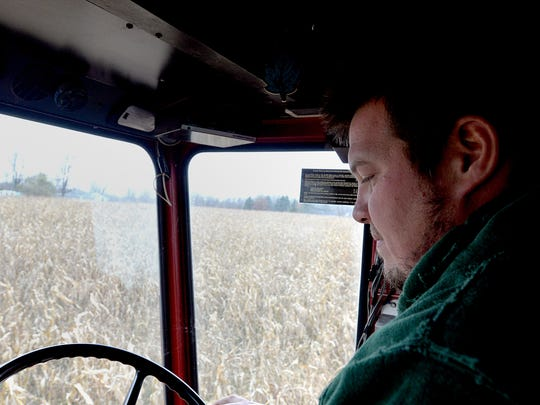 Organic farmer, William Baese from Baese Family Farm in Elsie, runs his combine through a field of corn Sunday November 9, 2014.