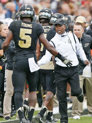 Head coach Darrell Hazell congratulates Domonique Young after Young's touchdown reception at 10:30 in the second quarter against Cincinnati Saturday, September 10, 2016, at Ross-Ade Stadium. Cincinnati defeated Purdue 38-20.
